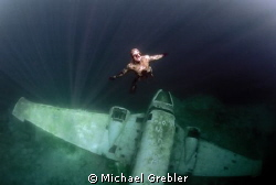 Apnea diver returning to the ice entry hole in Morrison's... by Michael Grebler 